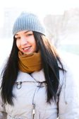 Playful Winter Woman outdoors in park. Looking at camera and smi — Stock Photo