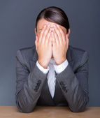 Portrait of tired business woman with face palm — Stock Photo
