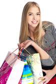 Zijaanzicht van vrouw met boodschappentassen tegen witte pagina — Stockfoto