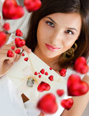 Young pretty attractive smiling woman with heart — Stock Photo