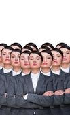 Många identiska affärskvinnor kloner. affärskvinna produktion co — Stockfoto