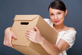 Closeup portrait of a young woman with boxes — Stock Photo