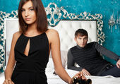 Fashion style photo of an attractive young couple inside luxury — Stock Photo