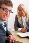 Young successful smiling business are working in the offi — Stock Photo