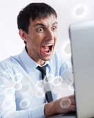 Attractive young man working with a laptop at his office. He is — Stock Photo