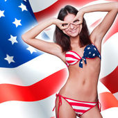 20-25 years old beautiful woman in swimsuit with american flag a — Stock Photo
