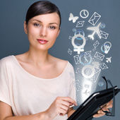 Portrait of pretty young woman holding Touch Screen tablet compu — Stock Photo