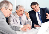 Portrait of three businessmen at the computer. — Stock Photo