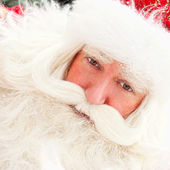 Portrait of Santa Claus standing outdoors. Snow falls. Natural l — Stock Photo