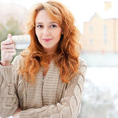 Portrait of beautiful red hair girl drinking coffee on winter ba — Stock Photo