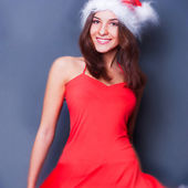 20-25 years od beautiful woman in christmas dress dancing — Stock Photo