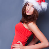 20-25 years od beautiful woman in christmas dress posing against — Stock Photo