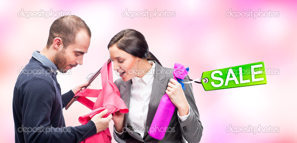 Portrait of adult beautiful couple shopping. Man gifting to his wife new dress and wine. Sale tag. — Stock Photo #8660050