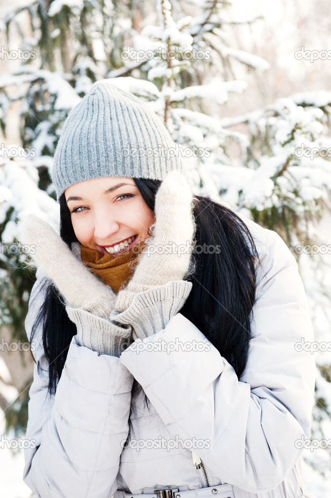 Portrait of young beautiful girl outdoors in winter having fun and looking at camera. Wearing warm clothes — Stock Photo #8660257