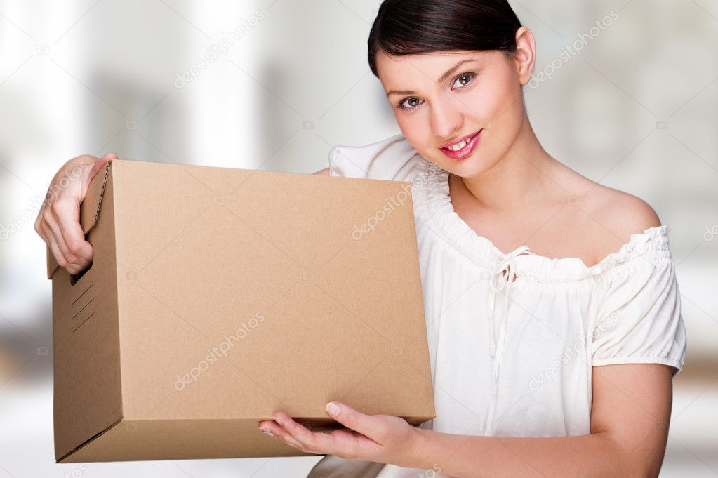 Young woman moving into a new home. Great copy space.  Stock Photo #8661583