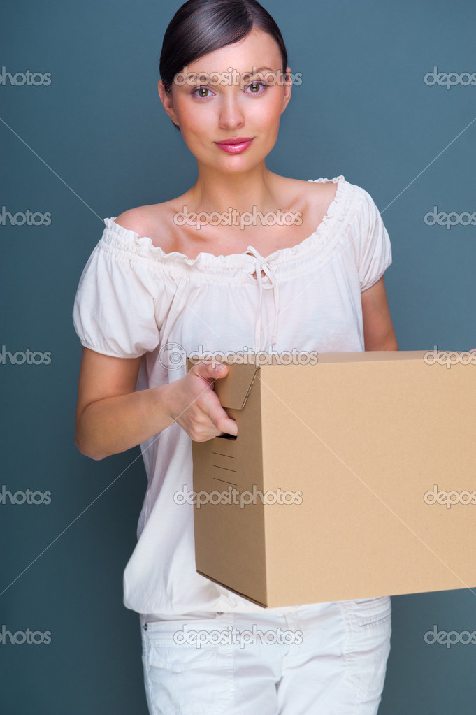 Closeup portrait of a young woman with box  Stock Photo #8661722