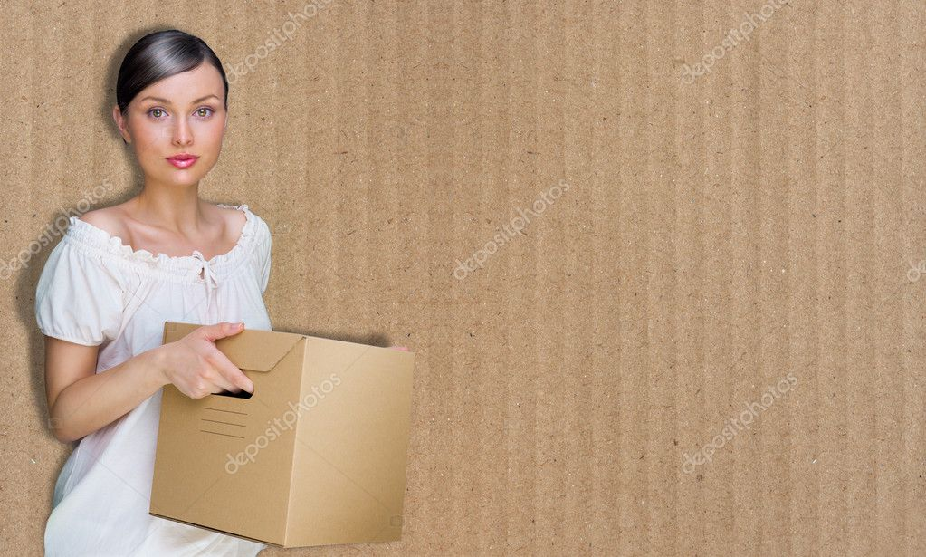 Closeup portrait of a young woman with box  Stock Photo #8661772