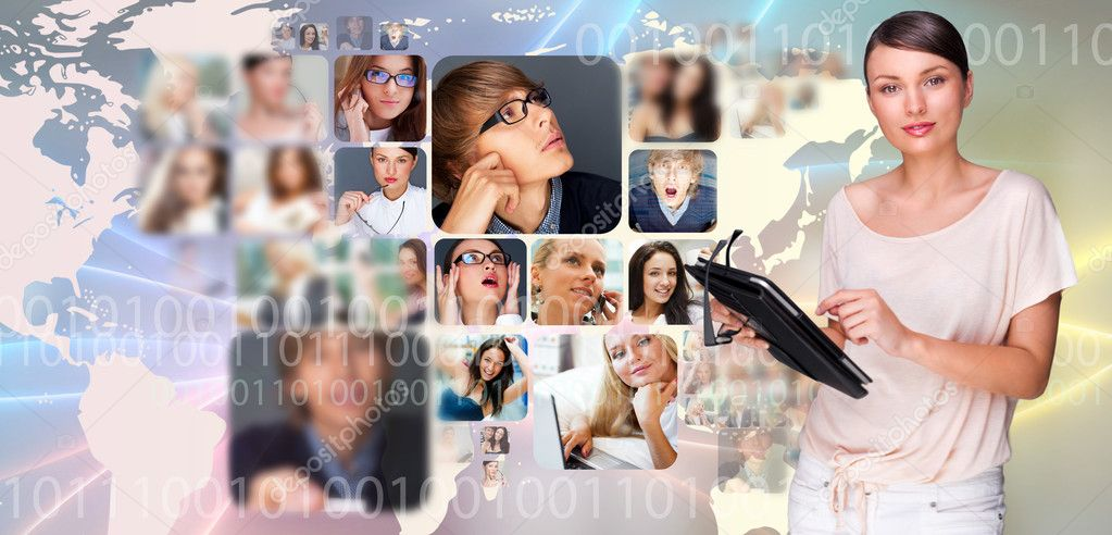 Portrait of young pretty woman working on modern tablet computer while standing against big virtual map with photo of her friends or colleagues — Stock Photo #8662557