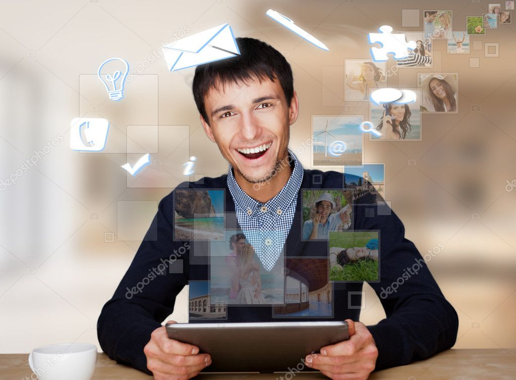 A businessman with icons floating around his head. Portrait of handsome guy working with his tablet pc looking at camera and smiling. Daily deals online. Workin — Stock Photo #8662953