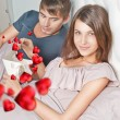 Stock Photo: Closeup portrait of a happy young couple relaxing on the bed. Ma