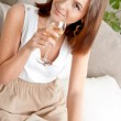 Elegant woman with champagne flute. Photo of beige warm colors — Stock Photo #8768190