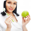 Beautiful young female dentist doctor with a toothbrush and gree — Stock Photo