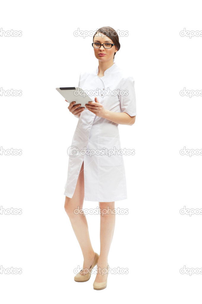 Young woman doctor wearing medical uniform using a touchscreen computer — Stock Photo #8768280