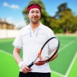 Mature business man playing tennis at his backyard of his house — Stock Photo #8773204