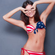 20-25 years old beautiful woman in swimsuit with american flag a — Stock Photo #8773228