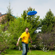 Man playing frisbee at his backyard — Stock Photo #8773380