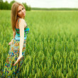 Young happy woman in field — Stock Photo
