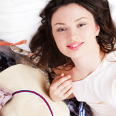 Portrait of young woman preparing for big trip and vacation she — Stock Photo