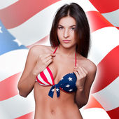 20-25 years old beautiful woman in swimsuit with american flag a — Zdjęcie stockowe