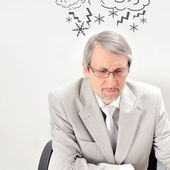 Closeup of a mature angry business man having a stress. Headache — Stock Photo