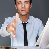 Portrait of an adult business man sitting in the office and hold — Stock Photo
