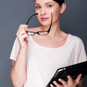 Portrait of young pretty woman holding tablet computer and glass — Stockfoto