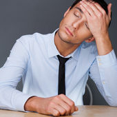 Closeup of a young business man having a stress. Headache. Again — Stock Photo
