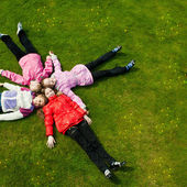Image of funny kids playing on the grass — Stock Photo
