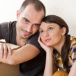 Stock Photo: Young Couple with boxes in the new apartment sitting on floor and planning