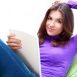 Young adult woman writing in her copybook while sitting on a large beanbag — Stock Photo #8984303