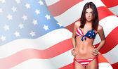 20-25 years old beautiful woman in swimsuit with american flag against patr — Φωτογραφία Αρχείου