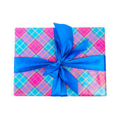 Big blue holiday bow on gift box isolated white background — Stock Photo
