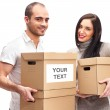 Young smiling couple carries a boxes — Stock Photo #9105753