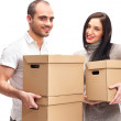 Young smiling couple carries a boxes — Stock Photo #9105793
