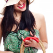 Stock Photo: Portrait of a beautiful young woman wearing summer hat and holding handbag