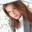 Young business woman holding umbrella while walking on street — Stock Photo #9105919