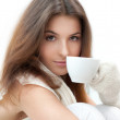 Portrait of a charming woman holding a cup of tea and daydreaming — Stock Photo #9105967