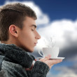 Portrait of a young man drinking coffee and breathing the smell — Stock Photo