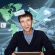 A business man is using the internet. A map of the Earth with glowing points of locations and lines of connections and technology images in the background — Stock Photo
