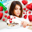 Portrait of young pretty woman eating tasty cakes on Valentines Day and graphic hearts are flying around her — Stock Photo